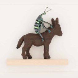 real beetle on little donkey