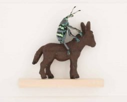 real beetle on little donkey